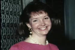 Smiling Lynn Amos with a pearl necklace