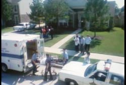 Paramedics and officers wheeling the covered body of Geri onto an ambulance