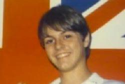 Smiling Matthew Chase with medium length hair