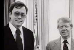 Michael Franke in suit and tie standing next to Jimmy Carter