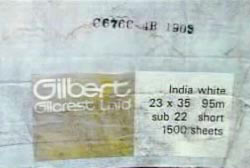 A box with information written on the side that reads 'India White, 23 x 35 95m sub22 short 1500 sheets'