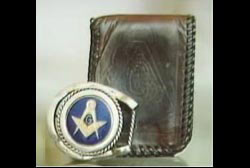 A wallet and belt buckle with freemason insignias