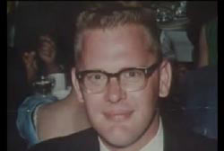 Smiling Ralph Probst with glasses in a suit