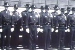 Many students standing at attention at a police academy