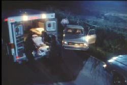 Police and EMT wheeling the covered body of Rhonda Hinson into the back of an ambulance