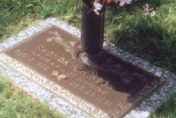 A bronze and stone commemorative gravesite for Rhonda Hinson