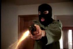 The gunman in skimask shooting his revolver