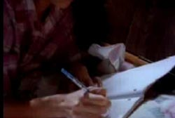 Su frantically writing of her harrasment in her diary