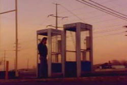'Don' standing in a phonebooth in the desert