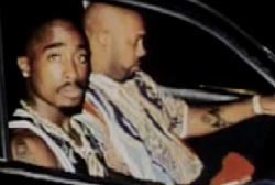 Tupac and Suge Knight in the front seat of a car