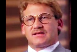 Dannion Brinkley with a small mustache and glasses
