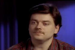 Don Decker with medium length hair and a small mustache