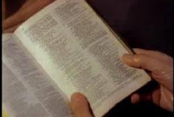 A priest holding a bible open