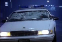 The gelatinous substance covering the windsheild of a police cruiser