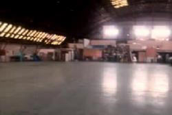 A large empty factory warehouse