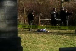 Police investigators looking over the lifless body of Jessica Keen in a cemetary