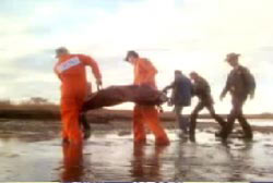 Investigators taking Lisa's body out of a river bank