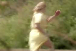 Margo in yellow clothes running into the woods