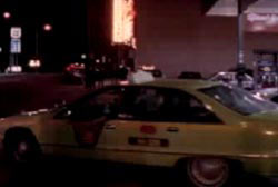 A taxi cab picking up Mia Zapata at night