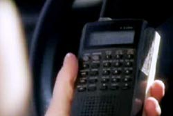 Pritchert holding a police scanner