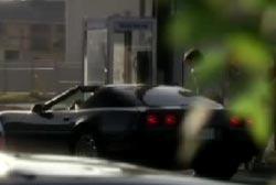 A black corvette picking up Nova at a payphone