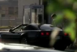 A black corvette picking up Nova at a payphone