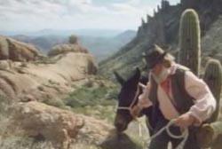 Jacob Waltz leading a mule through a ridge in the mountain