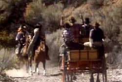 Plummers gang holding up a stagecoach at gunpoint