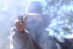 A gang member firing off a revolver leaving a cloud of gunsmoke