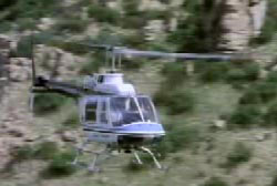 A helicopter flying through the canyon