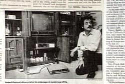 A news article with a photo of Dennis Sant kneeling infrot of a CRT television set