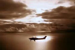 The Cessna 182 airplane flying over the ocean