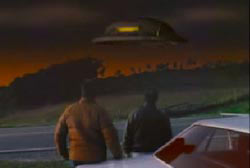 Two men outside of their car looking at a UFO hover over the horizon