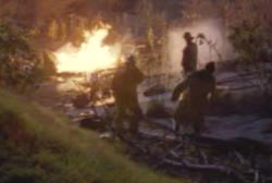Firefighters in forest at night trying to control a fire