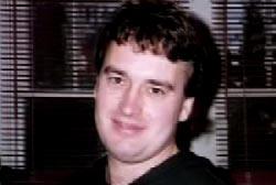 Smiling Blair Adams with dark hair