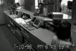 Security cam footage of blair leaning on the counter in a hotel lobby