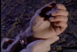 Chad's hand with a pen scribbling that reads 'March 3 Robert