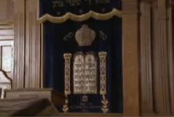 A banner with hebrew inscriptions in the main hall of a Yeshiva