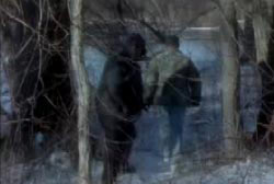 Two men in heavy clothing walking on a lake