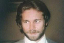 Smiling Don Kemp with beard and suit and tie
