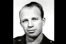 Smiling Frank Olson in a military uniform