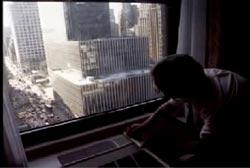 A hotel window overlooking the New York City Skyline