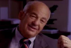 Dr. Cyril Wecht in a suit and tie