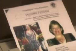 Someone holding a missing persons report for Judy smith that contains two photos of her