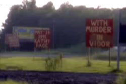 Signs errected near the site of the accident to commemorate the death of Kathy Page