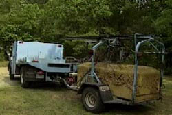 The exhumed caskett of Keith Warren being taken to a lab on a trailer to be tested