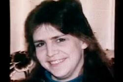 Smiling Linda Sherman with long black hair