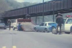 The blue car being towed by police