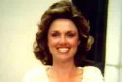 Smiling Patsy Wright with curly light brown hair