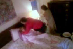 Patsy's family attempting to resuscitate her while she lays in bed